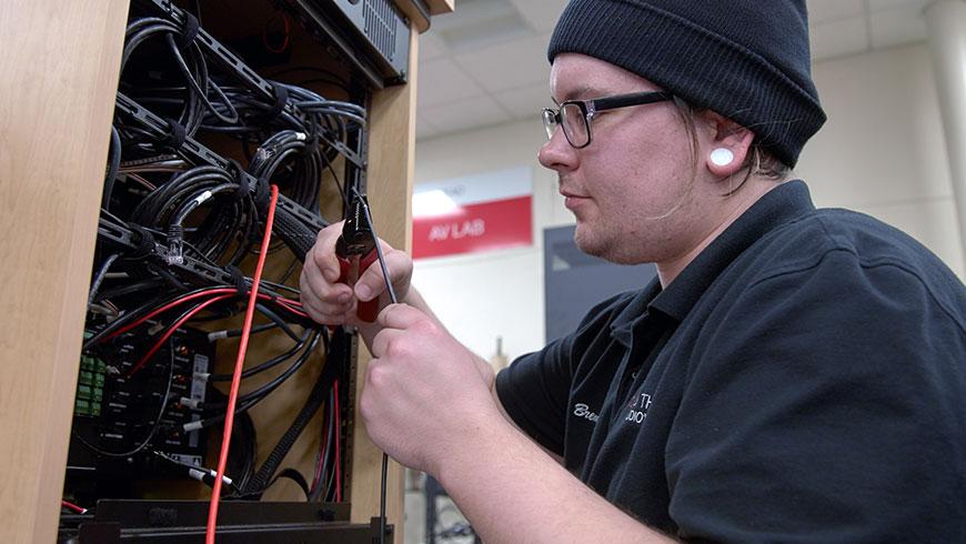 Technician works on executing audiovisual design