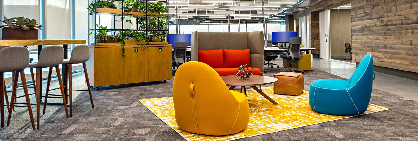 A bright modern office lounge area created with ancillary furniture
