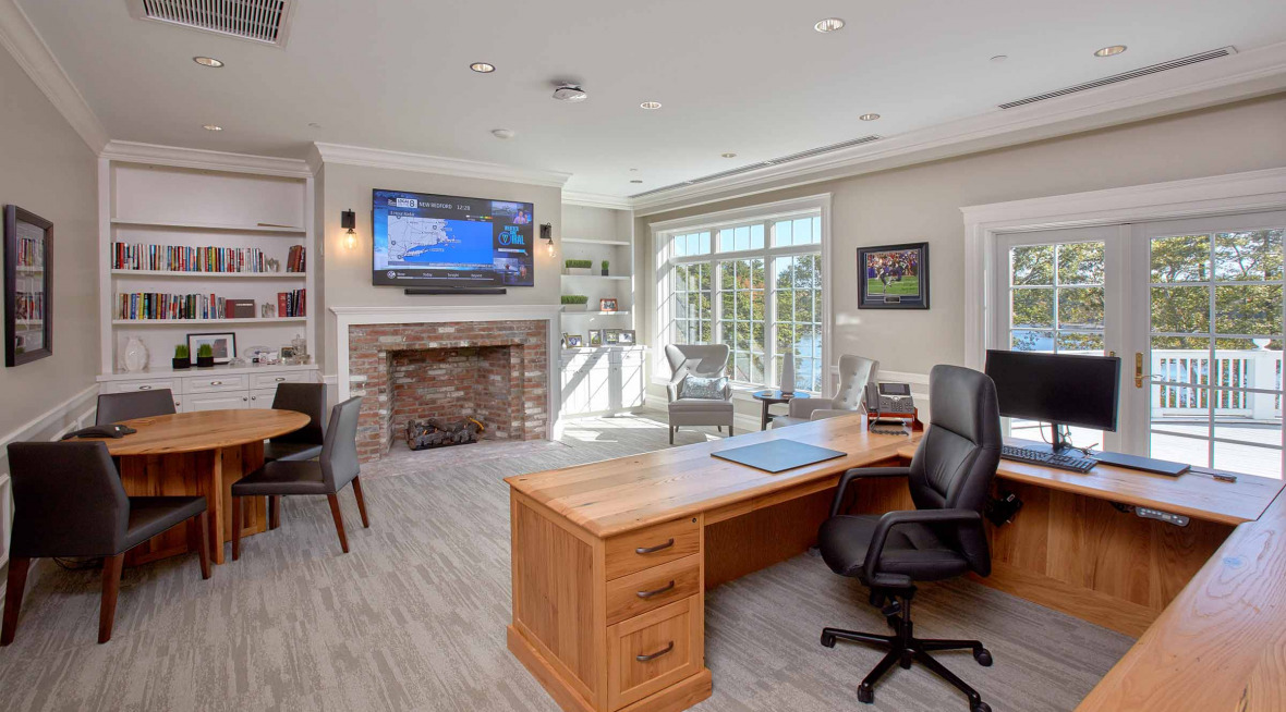 executive office with custom wood height-adjustable desk
