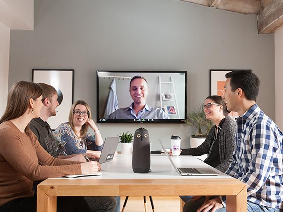 people collaborating using web conferencing and Meeting Owl